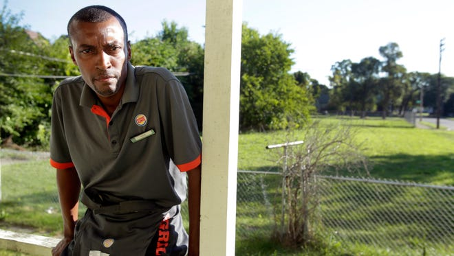 Cecil Euseary, a minimum wage worker at Burger King in Detroit, at his home.