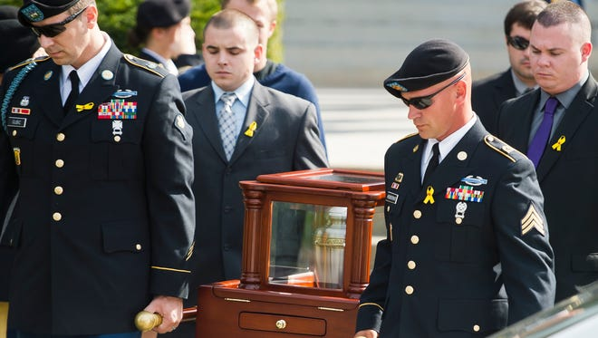 Pallbearers carry Joshua Pallotta's remains after his funeral ceremony at Ira Allen Chapel in Burlington on Monday morning. Pallotta, a soldier with the Vermont Army National Guard, was deployed to Afghanistan in 2010. He took his own life after an ongoing battle with post-traumatic stress disorder and traumatic brain injuries.