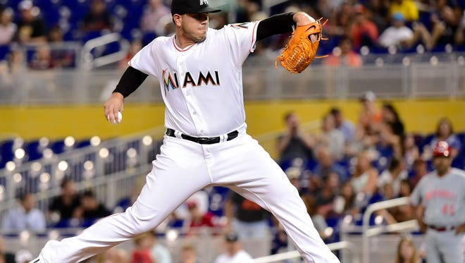 Miami Marlins starting pitcher Jose Fernandez (16) delivers a pitch during the first inning against the Cincinnati Reds at Marlins Park.