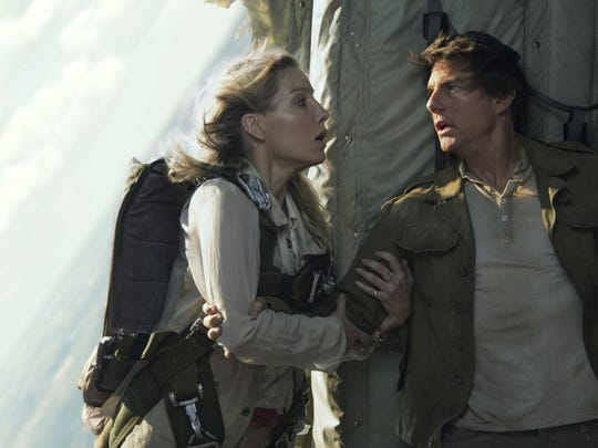 Seen here with co-star Annabelle wallis, Tom Cruise takes a break from his 'Jack Reacher' and 'Mission: Impossible' good guys to play a full-fledged antihero, and he wears the mantle well as a sexually self-obsessed, greedy jerk.