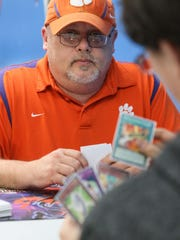 Jody Lusk, left, of Seneca plays a game of Yu-Gi-Oh! with Nick Burger of Honea Path on Saturday at Planet Comics in Anderson.