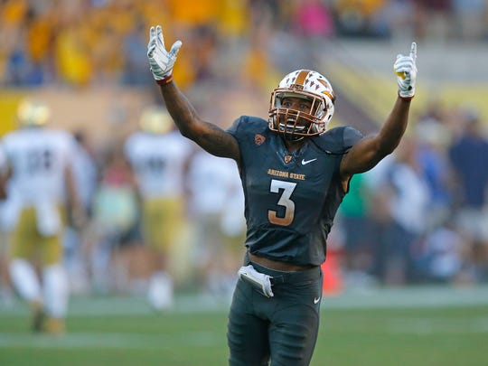Arizona State Sun Devils defensive back Damarious Randall (3) celebrates as defensive back Lloyd Carrington (8) returns  his interception for a touchdown late in the 4th quarter of their 55-31 win against the Notre Dame Fighting Irish.