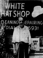 White Hat Shop, Business Isn't Booming, Ted Chronis outside his store and shoe shine shop, 1972 (Sheboygan Press)