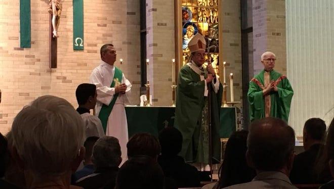 Archbishop Allen Vigneron and Father Gerald McEnhill co-celebrated the church's 75th anniversary Mass.