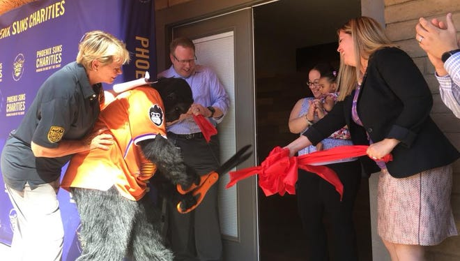 The Suns' Gorilla helps cut the ribbon at the Phoenix Dream Center's new learning center on Oct. 11, 2017.
