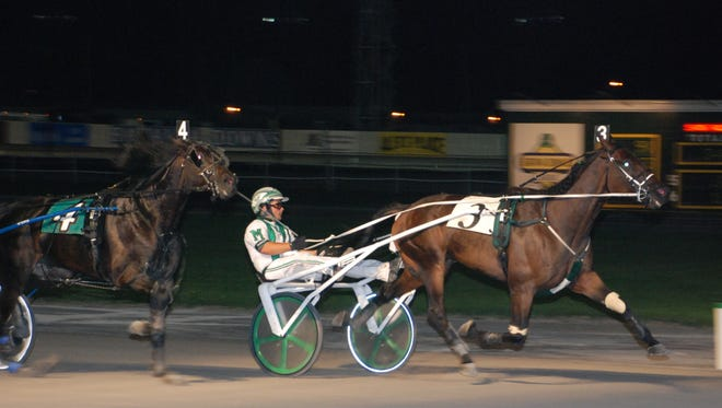Perfect Man hits the finish line first with David McNeight in the sulky during a Sept. 2, 2011, race at Batavia Downs.