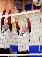 Churchill's Annie Yost (left) and Sarah Dunn (right) team up for the block against Grosse Pointe South.