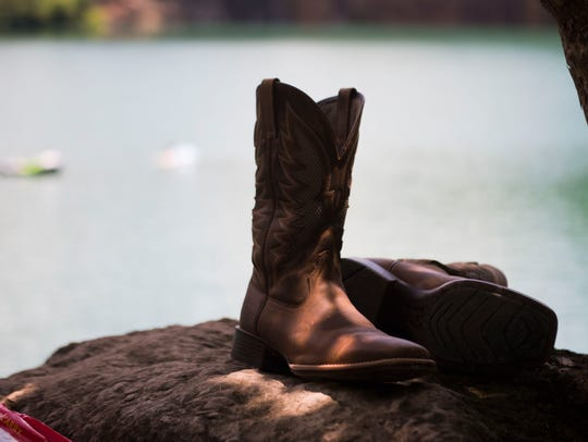 Boots sit on the side of Fort Dickerson Quarry in South
