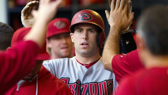 Arizona Diamondbacks first baseman Paul Goldschmidt high fives teammates in the dugout after scoring during the first inning against the Milwaukee Brewers at Miller Park.