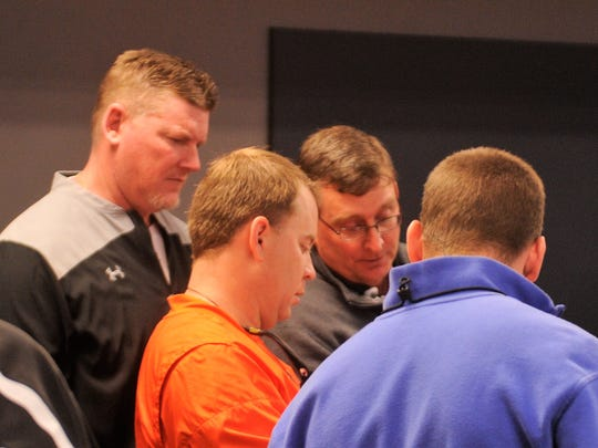 Abilene High head football coach Del Van Cox, middle, and defensive coordinator Mike Fullen, left, meet with two San Angelo Central coaches during the UIL Realignment meeting at the Birdville ISD Fine Arts and Athletics Complex on Thursday, Feb. 1, 2018.
