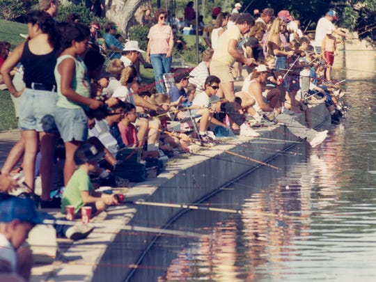 People line the banks of the Concho River for the children's Fishing Rodeo during the 1992 Fiesta del Concho.