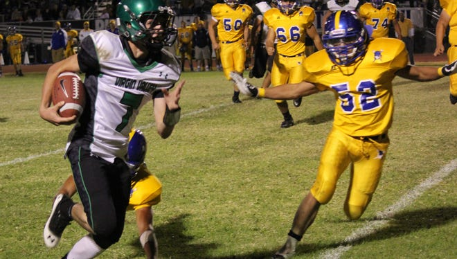 Bulldog quarterback Garrett Leavitt gets to the edge on a keeper during a 2012 game in Moapa Valley.