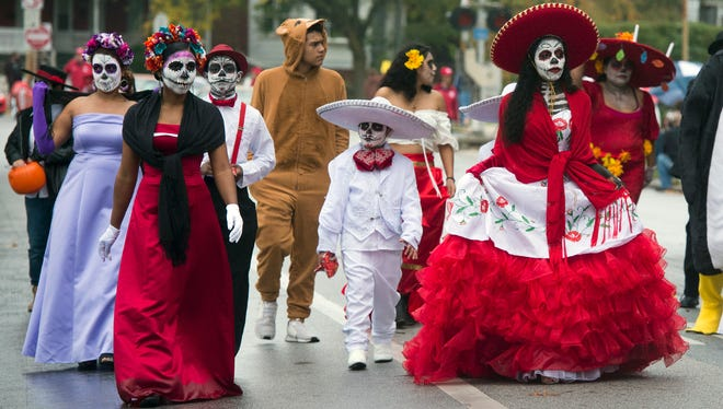 The Mexican Culture and Traditions group walks in the 68th annual York Halloween Parade.
