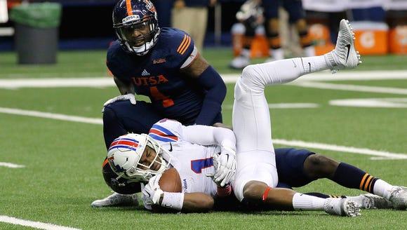 Louisiana Tech wide receiver Carlos Henderson suffered