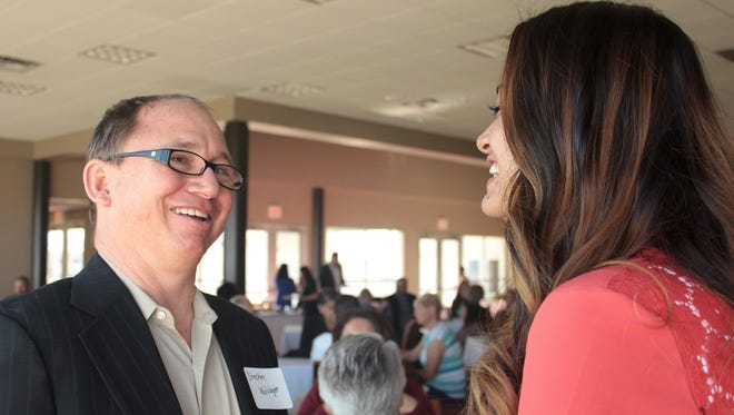 Stephen J. Wolslager, left, president of the Wolslager Foundation, speaks with New Mexico State University junior social work student April Tena, of Mesquite, N.M., at a breakfast Thursday, April 21, to celebrate the Wolslager family and its foundation's support of student scholarships. Tena received a Wolslager Scholarship while she pursued her associate degree at Doña Ana Community College. Since 2002, the Wolslager Foundation has supported non-traditional students through scholarships at DACC and NMSU. During that time, more than $2.29 million has been provided for students who might not have made the commitment to transformative higher education without it.
