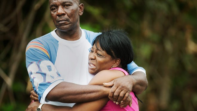 Family members of Jason Morse weep near the scene where Morse was shot and killed Wednesday in the Harlem Heights neighborhood of south Fort Myers.