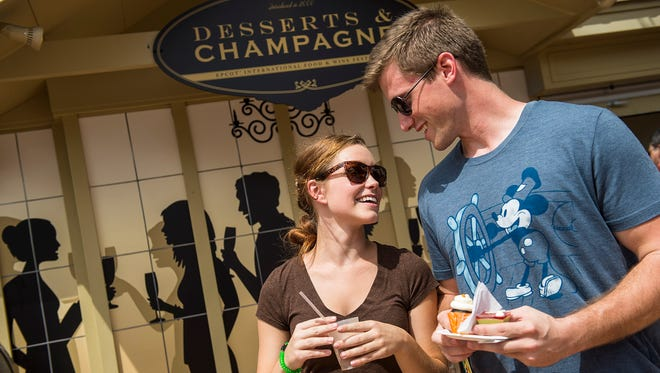 "Guests can sample tapas-sized tastes of inventive cuisine and beverages at the Desserts & Champagne Marketplace during the Epcot International Food & Wine Festival at Walt Disney World Resort in Lake Buena Vista, Fla. The popular fall festival also features wine tastings, culinary demonstrations, mixology seminars, nightly ""Eat to the Beat"" concerts and a broad range of premium dining events. (Matt Stroshane, photographer)"