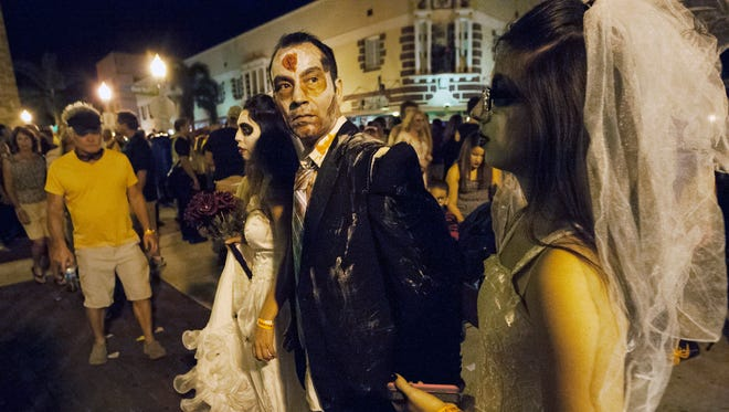 Thousands of people dressed as zombies filled the streets of downtown Fort Myers hours before the fatal shooting at Zombicon on Oct. 17, 2015.