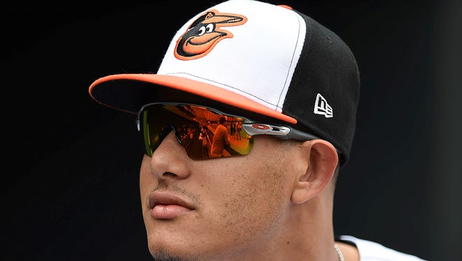 Baltimore Orioles' Manny Machado, waits in the dugout before being presented with his All-Star jersey before playing the Texas Rangers in a baseball game, Sunday, July 15, 2018, in Baltimore. (AP Photo/Gail Burton)