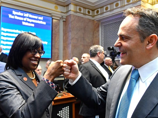 Gov. Matt Bevin and Lt. Gov. Jenean Hampton bump fists in January 2017 after swearing-in ceremonies that marked Republicans gaining the majority in both houses of the General Assembly.