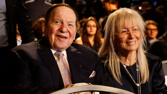 Chief executive of Las Vegas Sands Sheldon Adelson sits with his wife Miriam and waits for the presidential debate between Democratic presidential nominee Hillary Clinton and Republican presidential nominee Donald Trump at Hofstra University in Hempstead, N.Y. on Sept. 26, 2016.