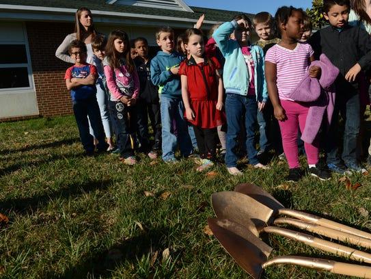 Gold painted shovels lay at the feet of Kegotank Elementary