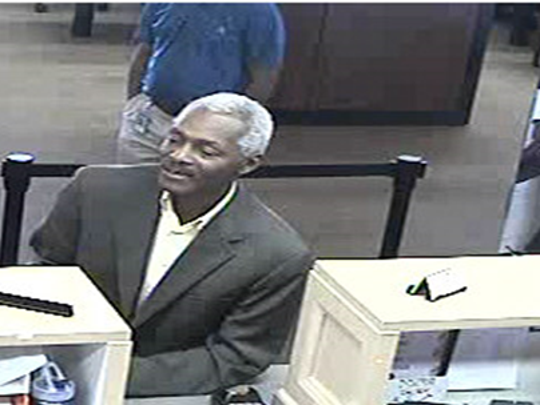 Surveillance image of a man wanted for identity theft.