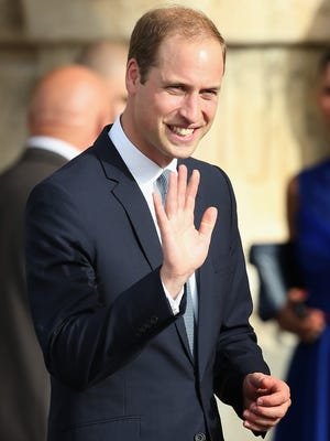 Prince William, Duke of Cambridge waves to members of the public as he arrives for an In Guardia Pageant in St George's Square during an official visit to Malta on Sept. 20, 2014 in Valletta, Malta.