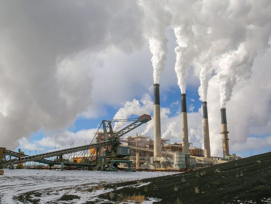 Large stacks fill the sky with steam at PacifiCorp's