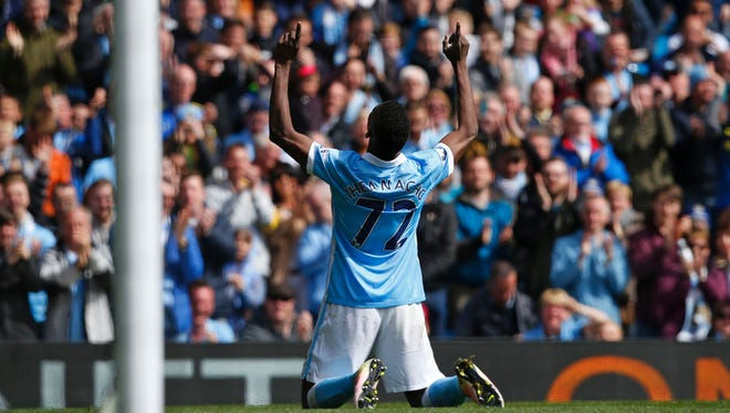 Manchester City's Kelechi Iheanacho celebrates after scoring the team's third goal.