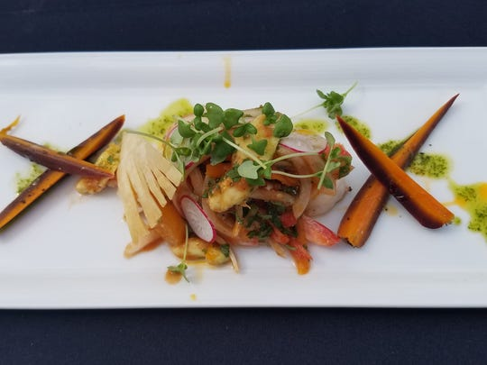 On day two of the Stuart Chopped competition, Chef Aldo Ramirez prepared Aldo's shrimp Escabeche with marinated vegetables, avocado, charred carrots, and fanned tortilla chips.