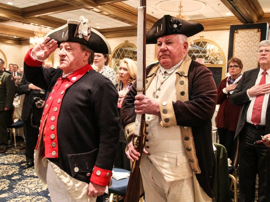 Charles Prestopine, of the 2nd NJ Regiment, on left, and Dick Clair, of the Lamb's Artillery Company, start with the posting of colors during the 142nd annual meeting and Washington's Birthday Celebration at the Madison Hotel in Morristown on February 15, 2016.