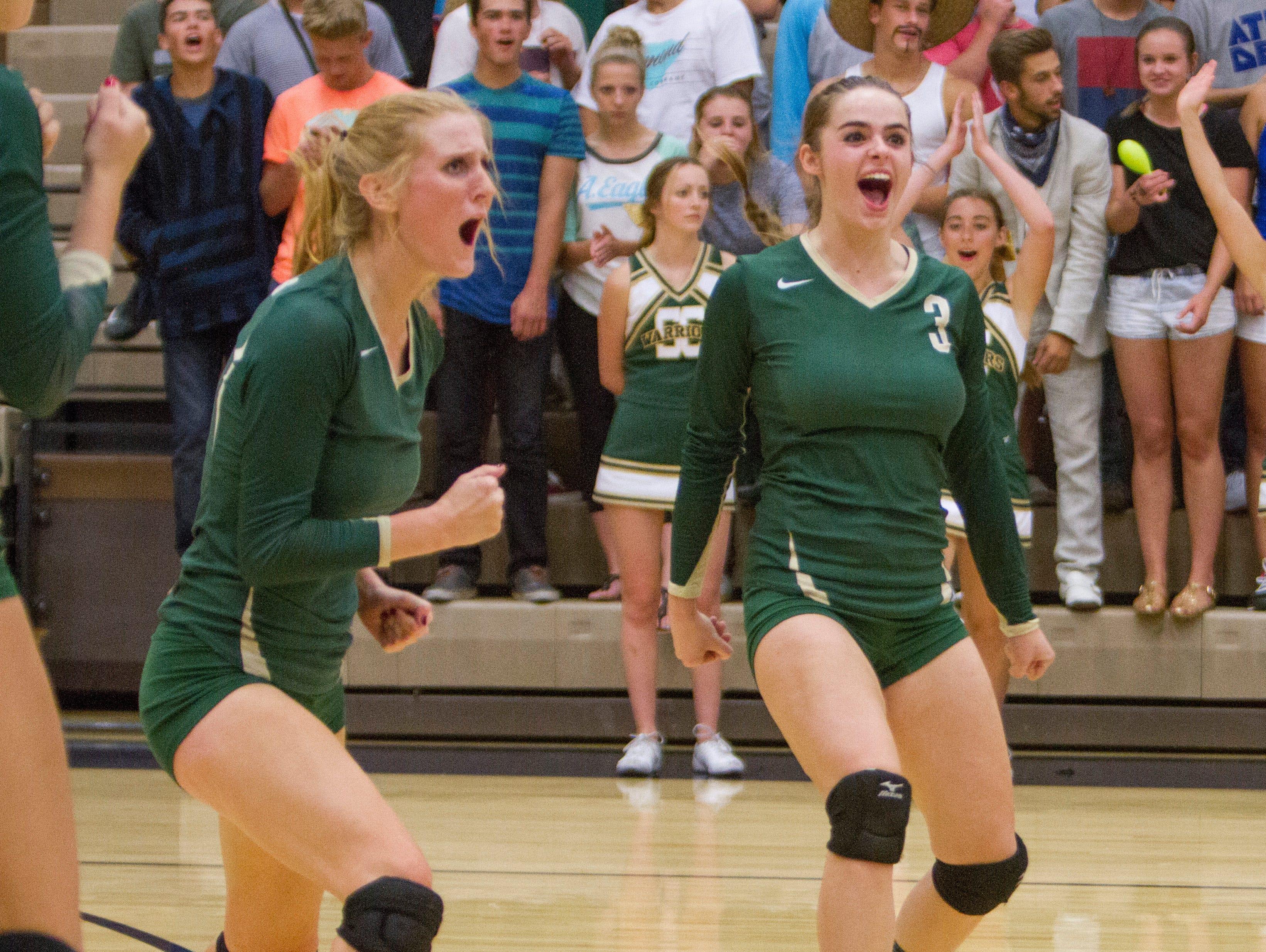 The Snow Canyon girls celebrate after scoring against Desert Hils Thursday, Sept. 24, 2015.