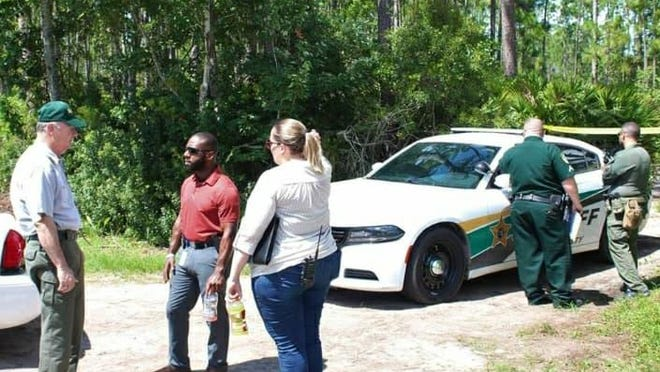 Flagler sheriff Rick Staly, right, talks to investigators at the scene of a death investigation in Palm Coast on Thursday.