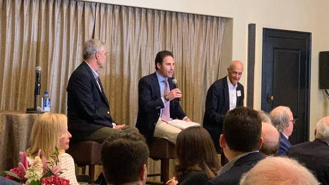 Michael Greenwald, a director at Tiedemann Advisors, moderates a discussion on cyber security with former Ambassador Douglas Lute (left), the former U.S. permanent representative to the North Atlantic Council, and Michael Chertoff (right), the former U.S. secretary of homeland security.