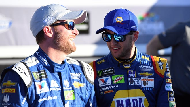 Chase Elliott (right) says he has no qualms about taking the pole from teammate Dale Earnhardt Jr.