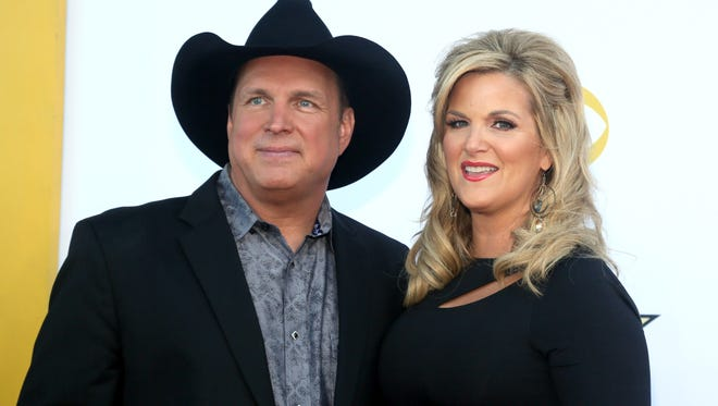 Garth Brooks, left, and Trisha Yearwood arrive at the 50th annual Academy of Country Music Awards in Arlington, Texas on April 19, 2015.