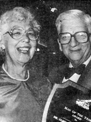A 1985 newspaper photo of my father, Clifford, getting a Man of the Year award, posing with my mother, Sylvia.