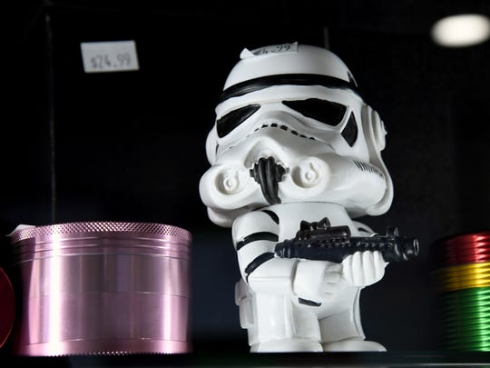 "Grinders, including one shaped like a stormtrooper from the ""Star Wars"" movie franchise, are displayed at Essence Vegas Cannabis Dispensary before the midnight start of recreational marijuana sales on June 30, 2017 in Las Vegas."