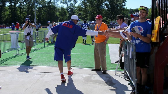Head coach Rex Ryan is greeted by fans during the start of training camp.