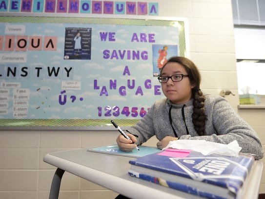 Kaylee Schuyler works on a lesson in the Oneida language