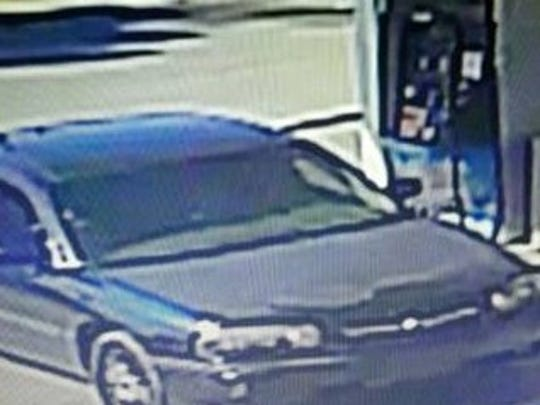 Authorities are asking for information about a black Chevrolet Impala with dark tinted windows and an Indiana temporary tag in the back window, believed to be the vehicle involved in an armed robbery at Roseville Pharmacy Saturday morning.