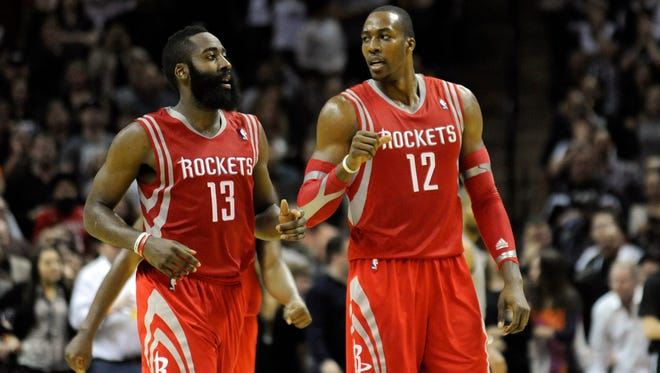 Houston Rockets guard James Harden (13) and forward Dwight Howard (12) need to work together to win big.