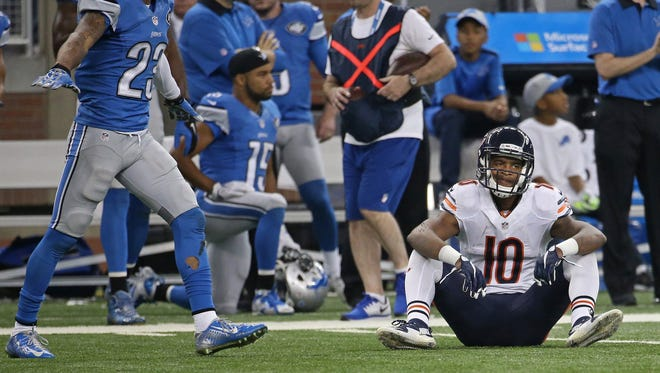 Chicago Bears wide receiver Marquess Wilson sits on the turf after not catching the ball in the third quarter at Ford Field on Sunday, Oct. 18, 2015, in Detroit.