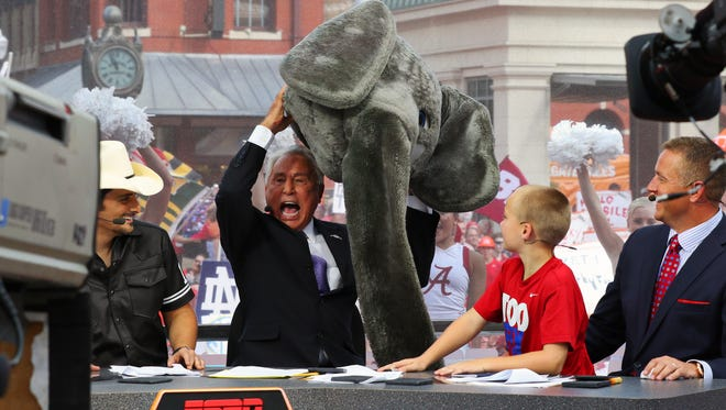 """Sep 5, 2015; Fort Worth, TX, USA; Guest picker Brad Paisley and Lee Corso and Chase Herbstreit (age 9) and Kirk Herbstreit as Corso picks the head gear of """"Big Al"""" the Alabama mascot on the set during the live broadcast of ESPN College GameDay at Sundance Square."""