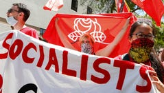 Members of the Democratic Socialists of America hold