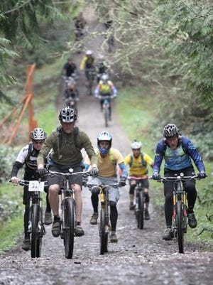 """Mountain bikers participate in """"Biketoberfest"""" in Port Gamble. The Kitsap County Parks Foundation is looking for funding to help create a mountain bike ride park in the Port Gamble Forest Heritage Park."""