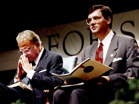 The Rev. Billy Graham prays next to the Rev. R. Albert Mohler Jr. in Mohler's first year as Southern Baptist Theological Seminary president Oct. 14, 1993, in Louisville, Ky.