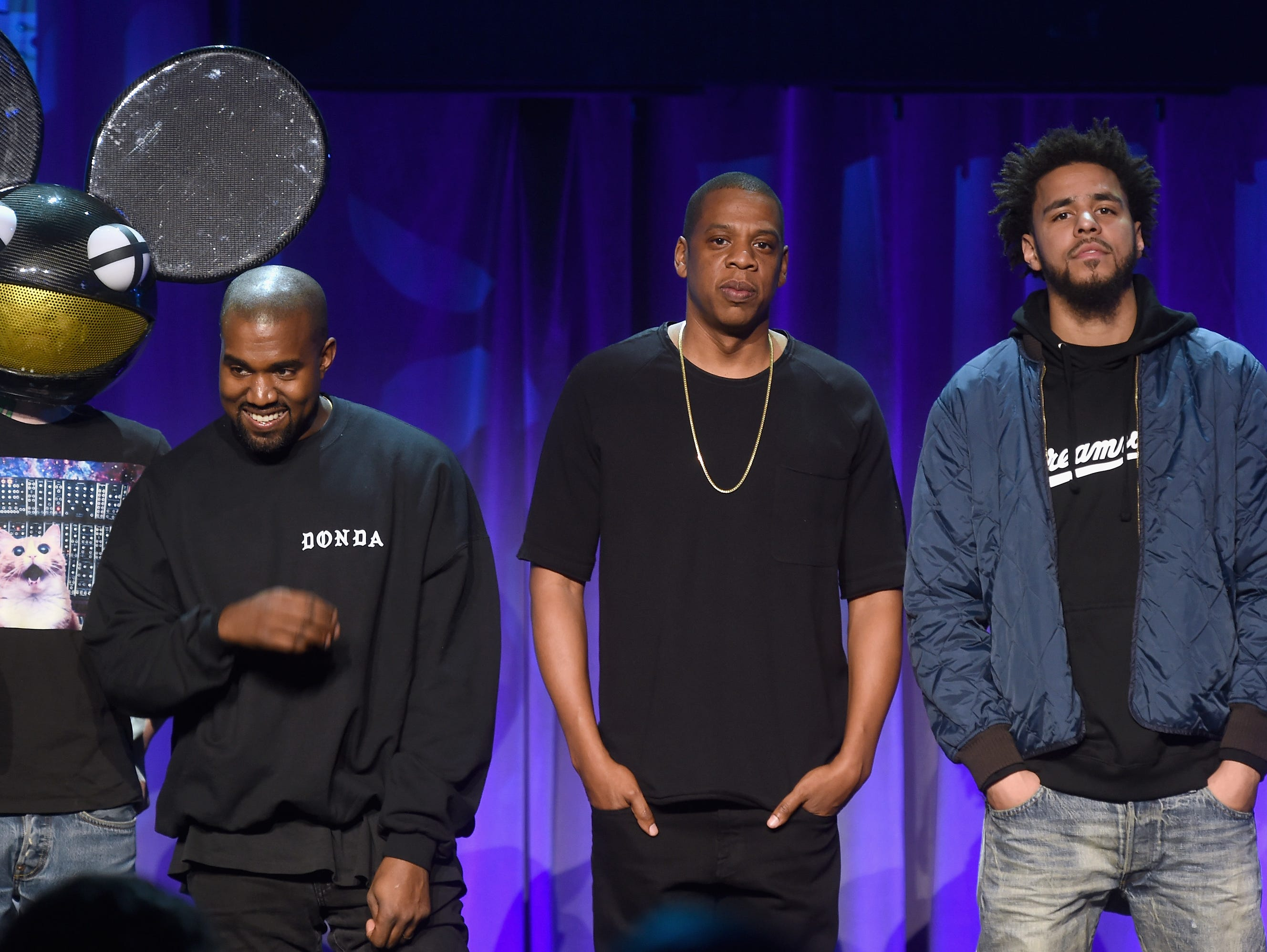 (L-R) Deadmau5, Kanye West, JAY Z and J. Cole onstage at the Tidal launch event at Skylight at Moynihan Station on March 30, 2015 in New York City.