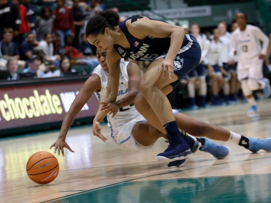 Connecticut forward Gabby Williams (15) and Tulane forward Maddison Wells (24) battle for a loose ball during the first half of an NCAA college basketball game in New Orleans, Wednesday, Feb. 21, 2018. (AP Photo/Scott Threlkeld)
